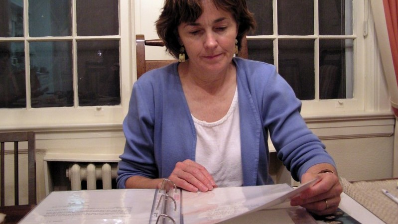 Women looks are binder of paperwork