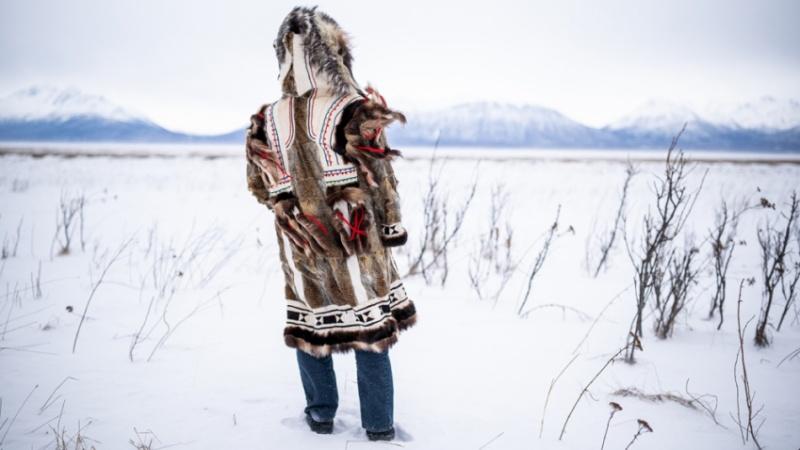 Person standing in snowy Alaska