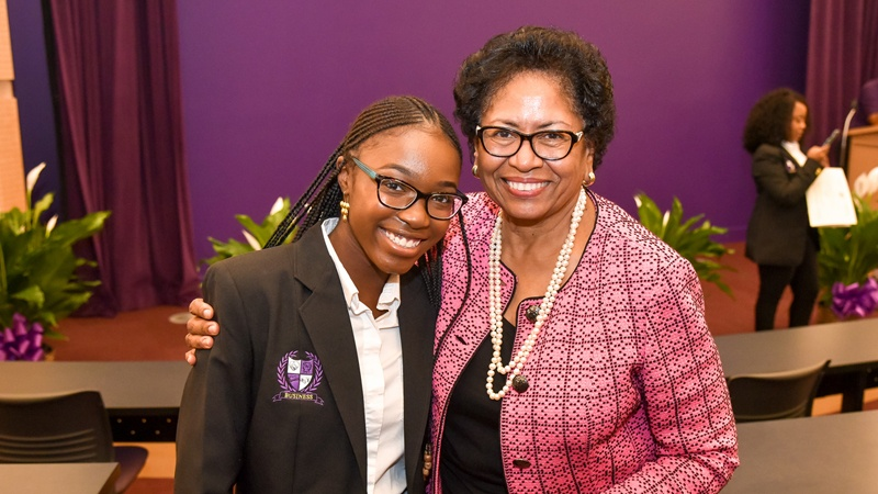 Ruth Simmons smiling with a student